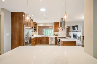 Photo 13: 1306 Hamilton Street NW in Calgary: St Andrews Heights Detached for sale : MLS®# A1151940