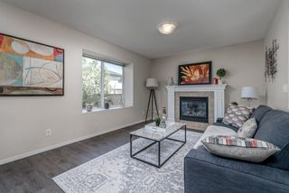 Photo 9: 122 Luxstone Road SW: Airdrie Detached for sale : MLS®# A1129612