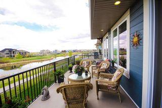 Photo 41: 67 CIMARRON SPRINGS CI: Okotoks House for sale : MLS®# C4108222