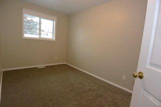 Photo 9: Unit A 3568 3rd Avenue Smithers | Half Duplex