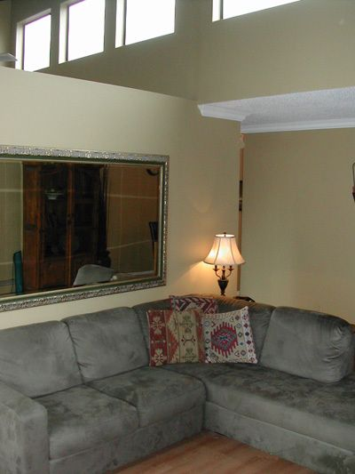 Living Room - 14' Vaulted Ceilings & South Facing Windows - Lots of Light!