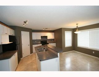 Photo 6: 11323 ROCKYVALLEY Drive NW in CALGARY: Rocky Ridge Ranch Residential Detached Single Family for sale (Calgary)  : MLS®# C3360614