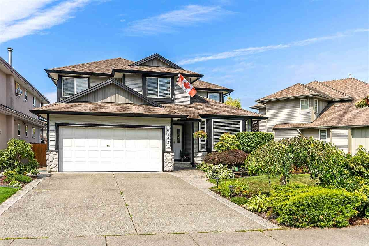 """Main Photo: 6863 183 Street in Surrey: Cloverdale BC House for sale in """"Cloverwoods"""" (Cloverdale)  : MLS®# R2394519"""