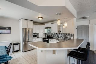 Photo 8: 87 Silver Creek Boulevard NW: Airdrie Detached for sale : MLS®# A1137823