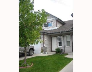 Photo 1:  in CALGARY: Millrise Townhouse for sale (Calgary)  : MLS®# C3342552
