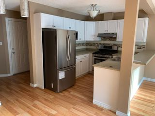 Photo 2: 9, 14603 Miller Blvd NW in Edmonton: Zone 02 House Half Duplex for sale : MLS®# E4215123