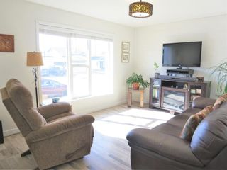 Photo 3: 1558 McAlpine Street: Carstairs Semi Detached for sale : MLS®# A1081216