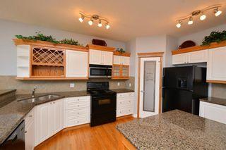 Photo 13: 303 GLENEAGLES View: Cochrane House for sale : MLS®# C4130061