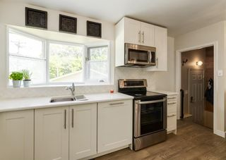 Photo 11: 5812 21 Street SW in Calgary: North Glenmore Park Detached for sale : MLS®# A1128102