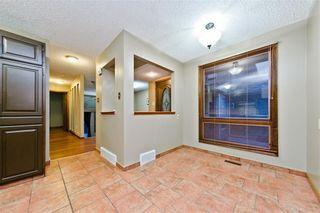 Photo 9: EDGEMONT ESTATES DR NW in Calgary: Edgemont House for sale : MLS®# C4221851
