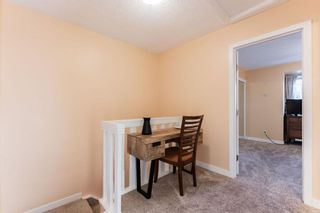 Photo 11: 1441 Ranchlands Road NW in Calgary: Ranchlands Row/Townhouse for sale : MLS®# A1061548