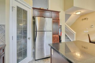 Photo 12: 301 Inglewood Grove SE in Calgary: Inglewood Row/Townhouse for sale : MLS®# A1118391