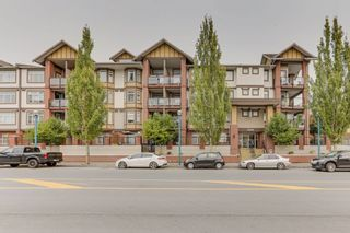"""Photo 1: 440 5660 201A Street in Langley: Langley City Condo for sale in """"Paddington Station"""" : MLS®# R2499578"""