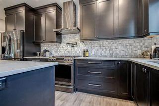 Photo 7: 715 71 Avenue SW in Calgary: Kingsland Detached for sale : MLS®# A1134081