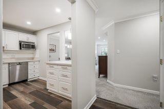 "Photo 3: #306 15350 19A Avenue in Surrey: King George Corridor Condo for sale in ""STRATFORD GARDENS"" (South Surrey White Rock)  : MLS®# R2621631"