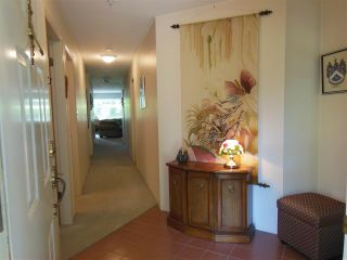 """Photo 4: 309 1000 BOWRON Court in North Vancouver: Roche Point Condo for sale in """"Parkway Terrace"""" : MLS®# R2178474"""