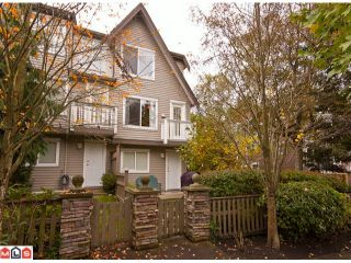 "Photo 1: 34 15355 26TH Avenue in Surrey: King George Corridor Townhouse for sale in ""South Wynd"" (South Surrey White Rock)  : MLS®# F1025838"