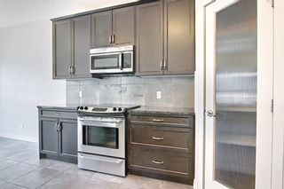 Photo 11: 61 Everhollow Green SW in Calgary: Evergreen Detached for sale : MLS®# A1115077