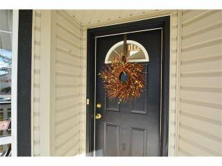 Photo 2: 108 GLENEAGLES Terrace: Cochrane House for sale : MLS®# C4113548