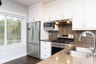 """Photo 8: 40 6971 122 Street in Surrey: West Newton Townhouse for sale in """"Aura"""" : MLS®# R2120843"""