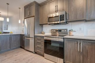 Photo 11: 510 Nolan Hill Boulevard NW in Calgary: Nolan Hill Row/Townhouse for sale : MLS®# A1050791