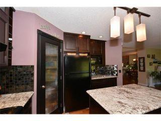 Photo 6: 148 GLENEAGLES Close: Cochrane House for sale : MLS®# C4010996