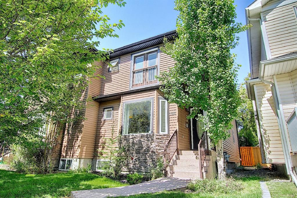 Main Photo: 722 53 Avenue SW in Calgary: Windsor Park Semi Detached for sale : MLS®# A1142583