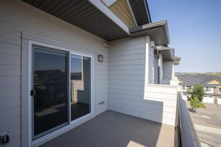 Photo 27: 9308 101 Sunset Drive: Cochrane Apartment for sale : MLS®# A1141889