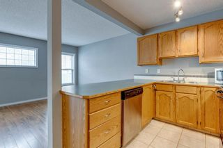 Photo 4: 57 Millview Green SW in Calgary: Millrise Row/Townhouse for sale : MLS®# A1135265