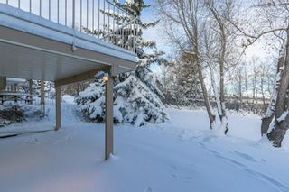 Photo 2: 113 Shawnee Rise SW in Calgary: Shawnee Slopes Semi Detached for sale : MLS®# A1068673