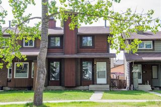 Main Photo: 6519 Coach Hill Road SW in Calgary: Coach Hill Semi Detached for sale : MLS®# A1129484