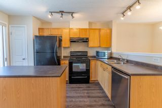 Photo 15: 119 Toscana Gardens NW in Calgary: Tuscany Row/Townhouse for sale : MLS®# A1121039