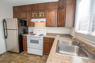 Photo 7: 6519 Coach Hill Road SW in Calgary: Coach Hill Semi Detached for sale : MLS®# A1129484