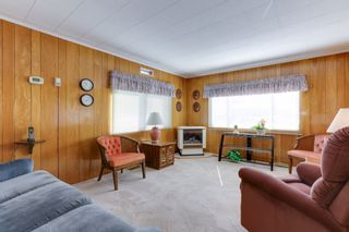 Photo 1: 52 9080 198 Street: Manufactured Home for sale in Langley: MLS®# R2562406