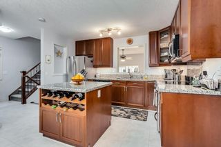 Photo 9: 20 CRYSTAL SHORES Cove: Okotoks Row/Townhouse for sale : MLS®# C4238313