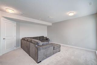 Photo 32: 907 Jumping Pound Common: Cochrane Row/Townhouse for sale : MLS®# A1132952