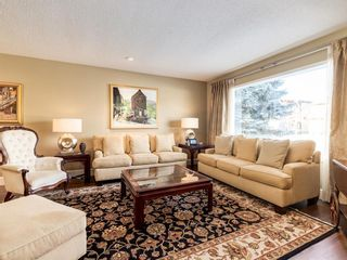 Photo 3: 407 49 Avenue SW in Calgary: Elboya Detached for sale : MLS®# A1060455