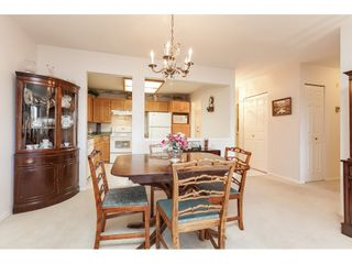 """Photo 18: 201 5375 205 Street in Langley: Langley City Condo for sale in """"Glenmont Park"""" : MLS®# R2482379"""