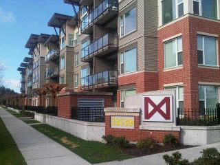 """Photo 1: 202 33539 HOLLAND Avenue in Abbotsford: Central Abbotsford Condo for sale in """"The Crossing - Building B"""" : MLS®# R2517839"""