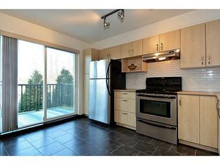 "Photo 2: 34 15155 62A Avenue in Surrey: Sullivan Station Townhouse for sale in ""Oaklands in Panorama Place"" : MLS®# F1442815"