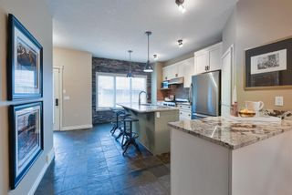 Photo 12: 175 Ypres Green SW in Calgary: Garrison Woods Row/Townhouse for sale : MLS®# A1103647