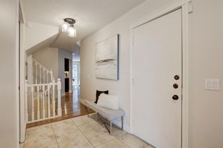 Photo 4: 212 Coachway Lane SW in Calgary: Coach Hill Row/Townhouse for sale : MLS®# A1153091