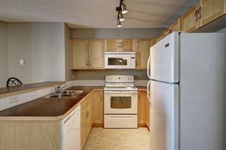 Photo 8: 2311 43 COUNTRY VILLAGE Lane NE in Calgary: Country Hills Village Apartment for sale : MLS®# A1031045