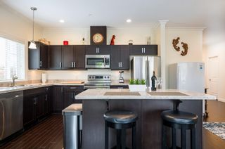"""Photo 11: 411 20281 53A Avenue in Langley: Langley City Condo for sale in """"Gibbons Layne"""" : MLS®# R2621680"""