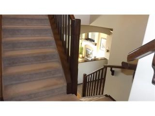 Photo 10: 155 SUNSET Close: Cochrane House for sale : MLS®# C4037159