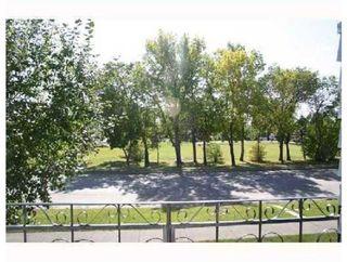 Photo 2: 220 50 Avenue: Claresholm Semi Detached for sale : MLS®# C4048339