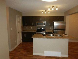 Photo 2: 3834 ALLAN Drive in Edmonton: Zone 56 Attached Home for sale : MLS®# E4228116