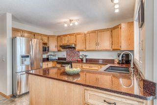 Photo 9: 210 Arbour Cliff Close NW in Calgary: Arbour Lake Semi Detached for sale : MLS®# A1086025