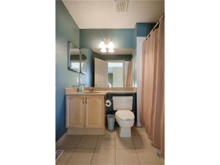 Photo 11: 76 STRATHLEA Place SW in Calgary: Strathcona Park House for sale : MLS®# C4092293