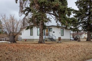 Photo 4: 901 42 Street SE in Calgary: Forest Lawn Detached for sale : MLS®# A1083425